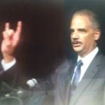 Eric Holder gives Satanic salute to followers