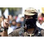 Fapatista leader gives Satanic salute to followers