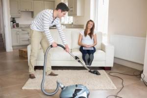 679-man-vacuuming
