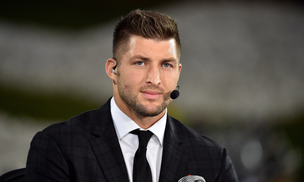 Nov 5, 2015; Columbia, MO, USA; EPSN analyst Tim Tebow looks on prior to the game between the Missouri Tigers and the Mississippi State Bulldogs at Faurot Field. Mandatory Credit: Jasen Vinlove-USA TODAY Sports