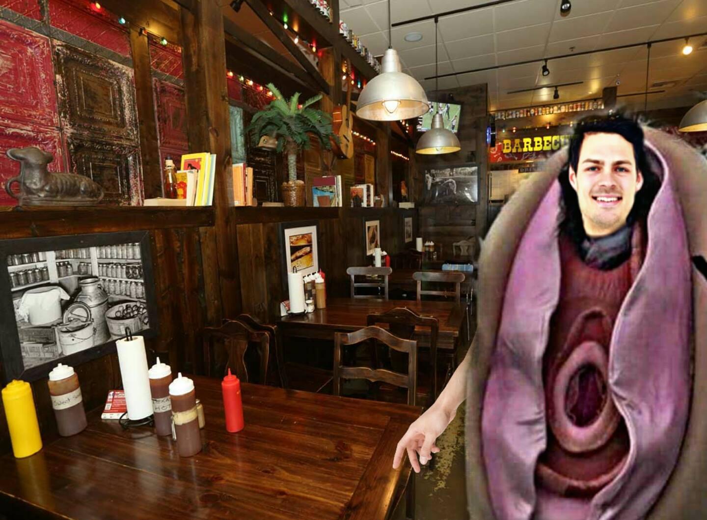Joe, showing off his new mascot at his local BBQ establishment.