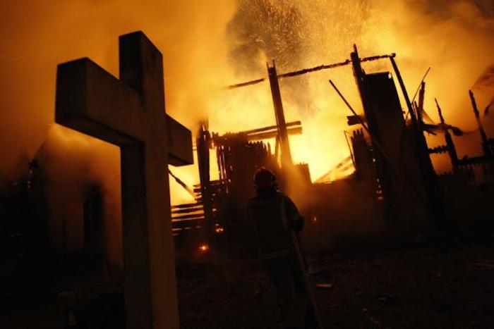 Firefighters battle to stop fire from destroying the house of God.